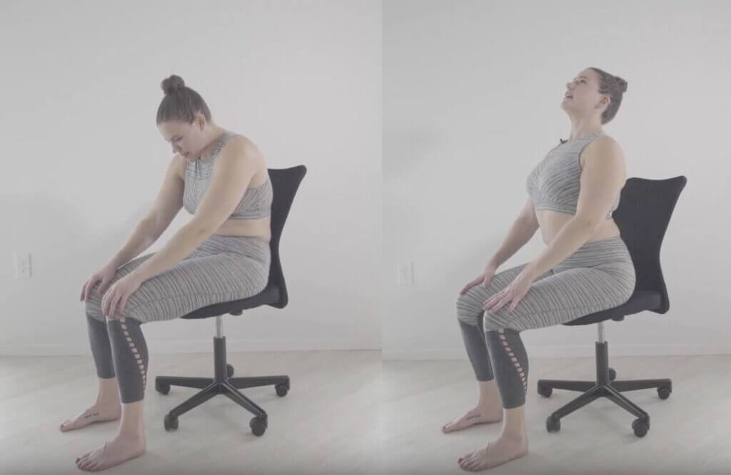 Two part image sitting on edge of black office chair Laura arches belly and head forward and back