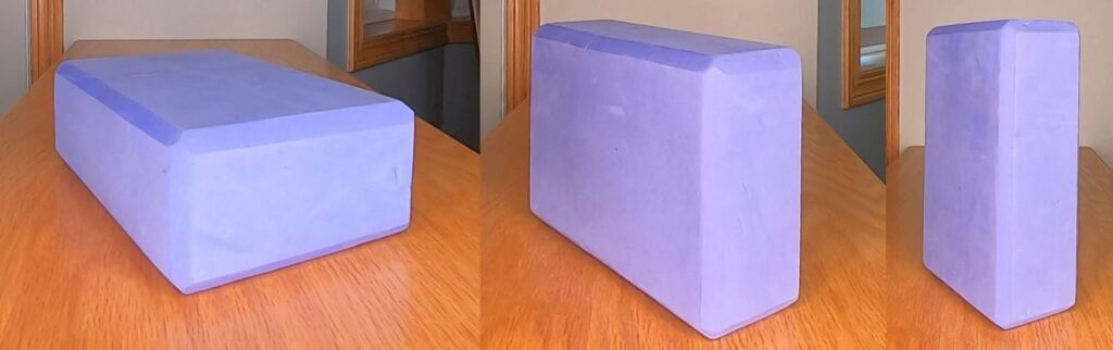 3 part image of single yoga block lain in different positions with different faces of the block down