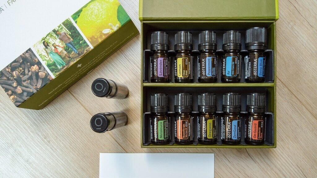 Essential oil kit from DoTerra of multiple bottles sitting next to a box on a tabletop