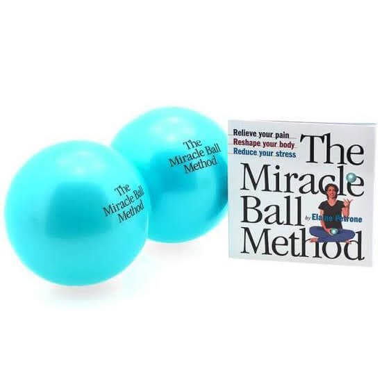 2 bright blue palm size balls with a small white square booklet cover reads The Miracle Ball Method