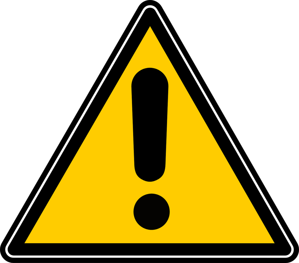 Yellow caution triangle with a black exclamation point in the center