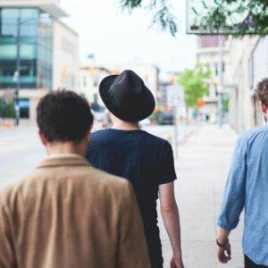 three men walking downtown city mens health e1613093404637