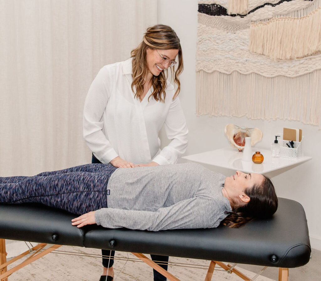 woman treating patient for in-person physical therapy session
